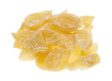 Crystallized ginger slices on white background Royalty Free Stock Photography