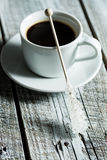 Crystallized sugar on wooden stick and coffee cup. Royalty Free Stock Images