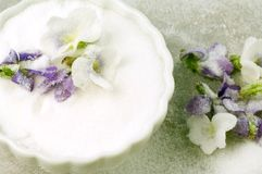 Crystallized Violets. Sit in a bowl of sugar Royalty Free Stock Photos