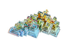 Crystals of bismuth on a white background Royalty Free Stock Photos