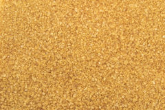 Crystals brown cane sugar background. Crystals brown cane sugar in the form of background royalty free stock photography