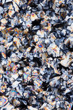 Crystals of citric acid. Abstract textured background created by crystals of Citric Acid viewed using a microscope and polarized light royalty free stock photos