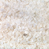 Crystals of common Sea salt close up. Square food background - crystals of common Sea salt close up stock photography