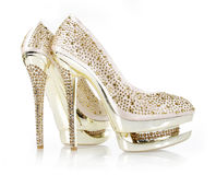 Crystals encrusted gold pair of shoes Royalty Free Stock Photo