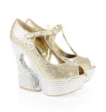 Crystals encrusted gold shoes Royalty Free Stock Photos
