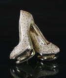 Crystals encrusted gold shoes Royalty Free Stock Photography