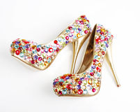 Crystals Encrusted Golden Heels. On a white background stock photography