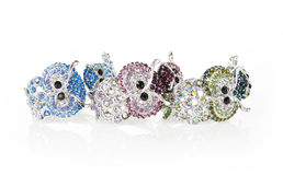 Crystals encrusted owls, bracelets Royalty Free Stock Images