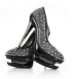 Crystals encrusted pair of black shoes Royalty Free Stock Images