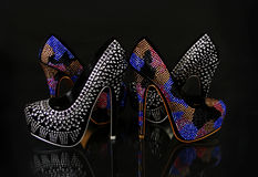 Crystals encrusted shoes collection on black Royalty Free Stock Images