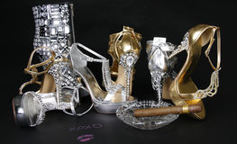 Crystals encrusted shoes collection and cigar Royalty Free Stock Image
