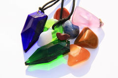 Crystals and gems. Various tachyon crystals and stones in the sun, showing translucent colours and neck bands Stock Image