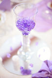 Crystals in a glass table decor Royalty Free Stock Photography