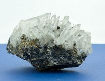 Crystals growing out oi f small stone. Blue surface white backgounrd stock images
