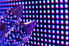 Crystals on the LED wall background. Bright colored stone crystals on the LED wall background  - close-up macro photo Stock Photos