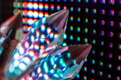 Crystals on the LED wall background. Bright colored stone crystals on the LED wall background  - close-up macro photo Royalty Free Stock Photos