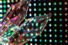 Crystals on the LED wall background. Bright colored stone crystals on the LED wall background  - close-up macro photo Stock Photo