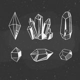 Crystals and minerals on a chalkboard. Set of minerals hand drawn on a chalkboard, vector illustration with crystals and minerals royalty free illustration