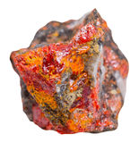 Crystals of red Realgar on rock isolated Stock Image