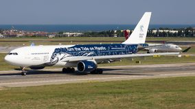 CS-TQW Hifly , Airbus A330-200. CS-TQW with Turn the tide on Plastics livery is rolling for take-off on runway 35L at Istanbul Ataturk Airport LTBA, July 7, 2018 stock photos
