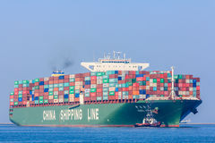 CSCL Venus container ship with tug boats Royalty Free Stock Photography
