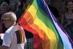 CSD, gay pride parade 2015 in Luebeck, Germany, man with rainbow Royalty Free Stock Photos