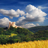 Csesznek Castle with blue cloudy sky in Hungary Stock Images