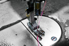 CSewing machine. Sewing machine foot closeup, focus on foot Royalty Free Stock Image