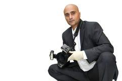 CSI. Police CSI investigator with gloves and camera Stock Image