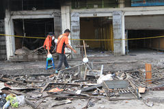 CSI. Crime Scene Investigation officers investigating the burning shopping center with a three-dimensional scanner in the city of Solo, Central Java, Indonesia Royalty Free Stock Photo