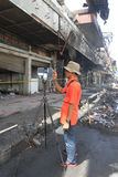CSI. Crime Scene Investigation officers investigating the burning shopping center with a three-dimensional scanner in the city of Solo, Central Java, Indonesia Stock Photos