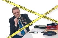 CSI crime scene investigator. CSI investigator researching office crime scene, taking fingerprints, weapon in foreground, white background, studio shot Royalty Free Stock Images