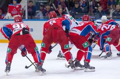 CSKA team on faceoff. MOSCOW - MARCH 12: A. Kuzmenko (96) and D. Denisov (6) on faceoff during hockey game Yokerit vs CSKA on Russia KHL championship on March 12 Royalty Free Stock Images