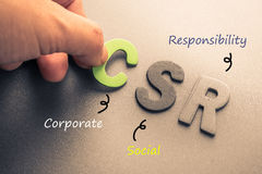 CSR. Closeup hand arrange wood letters as CSR abbreviation(Corporate social responsibility Royalty Free Stock Photos