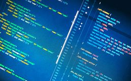 Css3 code on blue background. In the code editor, close up stock photos