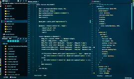 Css and php code on dark blue background, close up. Splitting of css and php code in the code editor, front view. Css and php code on dark blue background in the royalty free stock images