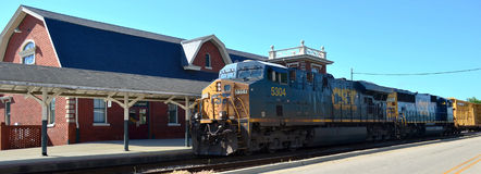 CSX Freight Train and Train Depot. CSX Freight Train passing in front of the Fayetteville, NC train station Stock Photos