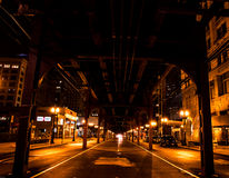 CTA train in Chicago at night in nightlife style. Under the CTA train in Chicago at night in nightlife style Stock Image