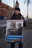 Ctivist of the national liberation movement. Yoshkar-Ola, Russia - March 18, 2015 Activist of the national liberation movement NOD with a poster Vladimir Putin stock photo