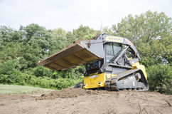 CTL Pushing Dirt. Compact Track Loader (CTL) pushing Dirt Royalty Free Stock Photo