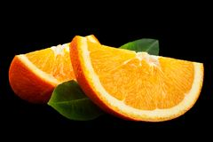 Ctrus fruit orange closeup. Isolated on black background stock photography