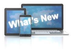 Cuál es nuevo en el ordenador portátil, la tableta digital y el smartphone Imagen de archivo libre de regalías