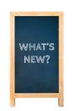 Cuál es nuevo mensaje de texto en el tablero de madera del marco Imagenes de archivo