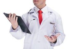 Cuídese con un lazo rojo que sostiene una tableta De alta resolución Fotografía de archivo libre de regalías