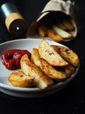 Cuñas asadas de la patata Foto de archivo libre de regalías