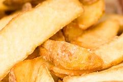 Cuñas fritas de la patata imagenes de archivo