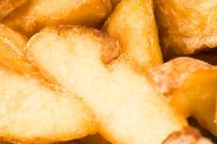 Cuñas fritas de la patata fotografía de archivo libre de regalías