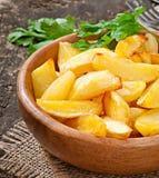 Cuñas fritas de la patata Fotos de archivo libres de regalías
