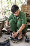 Cu Chi tunnels sandal maker Royalty Free Stock Image