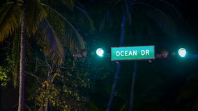 CU Time Lapse of Ocean Drive street sign at night stock footage